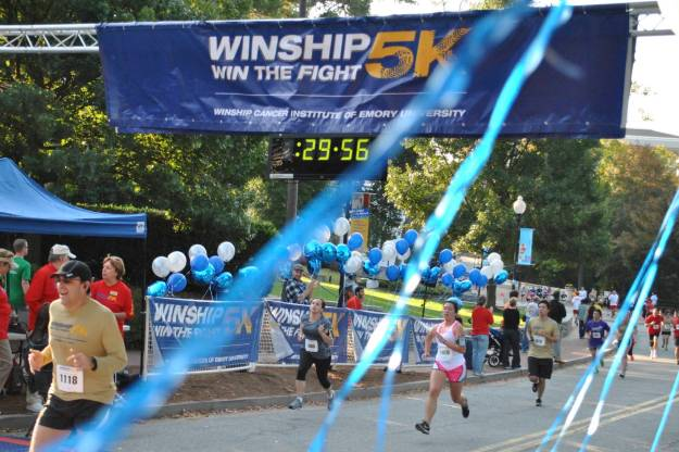 Crossing the finish line of my first 5k